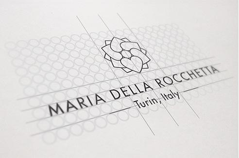 003   Maria della rocchetta costruzione logo * Comunicazione = OfficineMultiplo